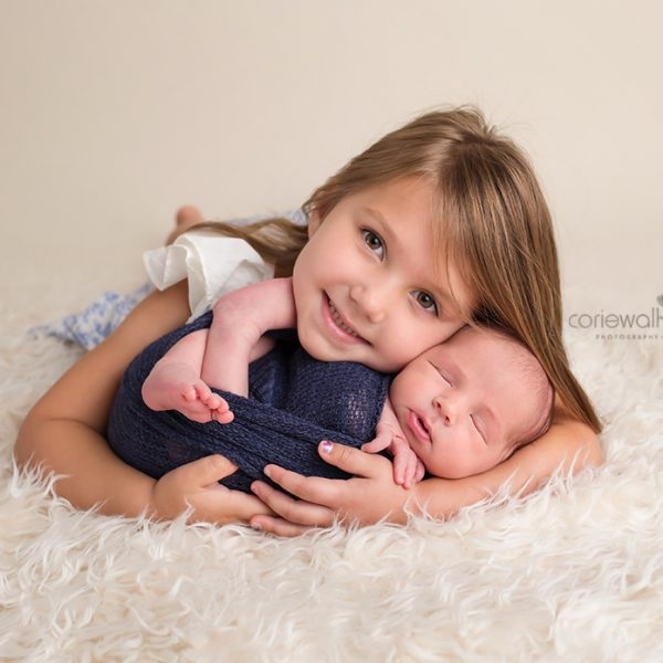 baby boy with big sister