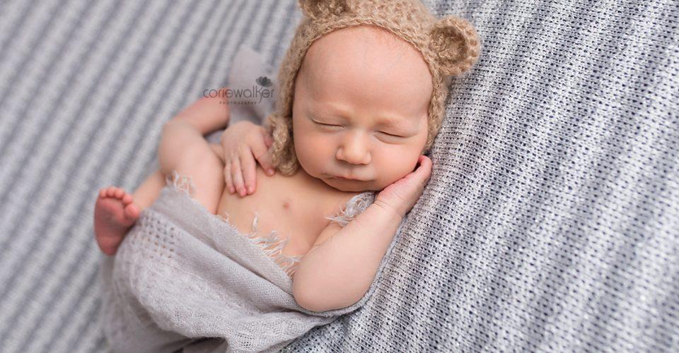 newborn baby in bear bonnet