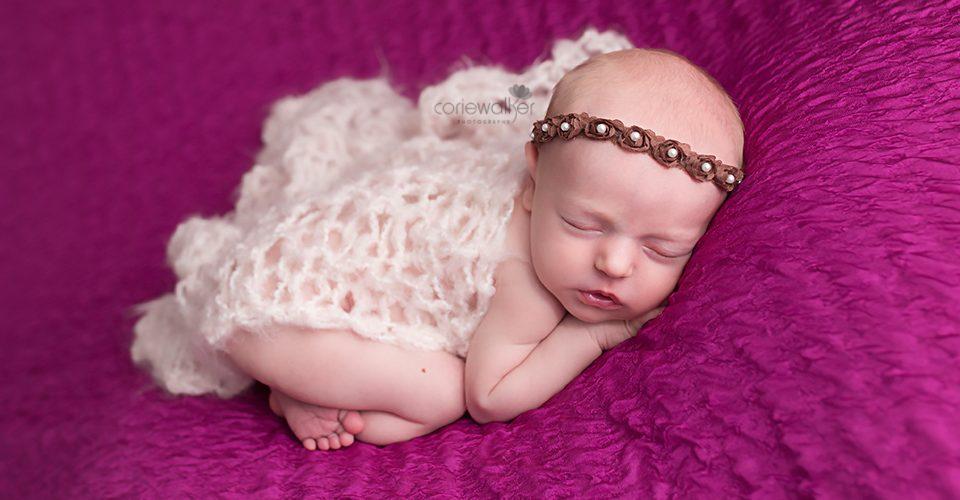newborn girl on magenta