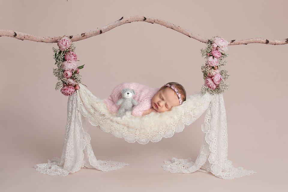 newborn on swing